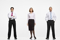 Businesspeople standing side by side arms crossed by side in pockets