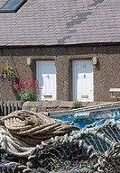 Fishing nets outside of a cottage, Boulmer, Northumberland, England