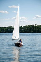 Person in sailboat, Lake of the Woods, Ontario, Canada