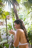 Woman taking a shower outdoors
