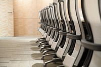 Row of chairs at conference table
