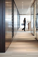 Businesswoman walking in office hallway