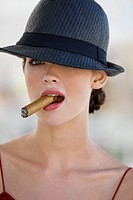Fashion model smoking a cigar (thumbnail)