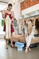 Two women shopping in a boutique (thumbnail)