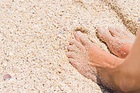 Close_up of man's feet on sand