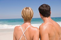 Rear view of a couple on the beach