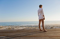 Woman standing on a boardwalk