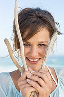 Portrait of a woman holding sticks and smiling