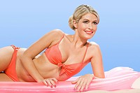 Woman in bikini on inflatable mattress