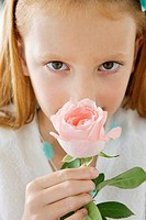 Close_up of a flower girl smelling a flower
