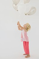 Girl holding balloons