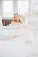 Portrait of a girl sitting at a dining table