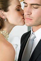 Bride kissing groom (thumbnail)