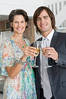 Woman and her son drinking champagne