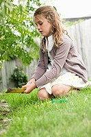Girl gardening with a shovel