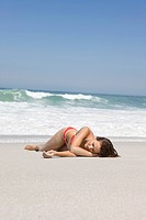 Woman lying on the beach (thumbnail)