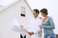 Couple looking at a blueprint of a house