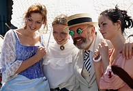 Dublin, Ireland, Human rights activist and senator, David Norris, celebrates Bloomsday with three young women