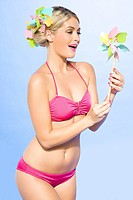Young woman in bikini with pinwheel