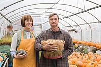 Farmer couple with produce