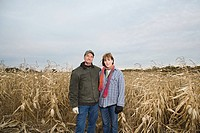 Farmer couple in corn field