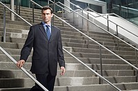 A businessman descending a staircase