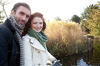 A happy couple beside the water in dulwich park