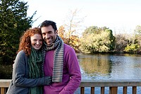 Portrait of a happy couple on a river bridge