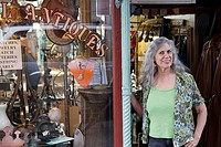 Antique shop keeper standing outside her shop