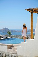Woman on terrace of resort, Cabo San Lucas, Mexico