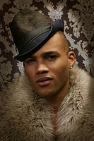 Man wearing fedora and fur collar