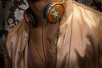 Close up of man with headphones around neck