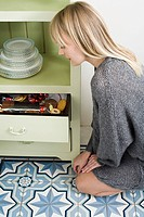 Young woman and drawer of cookies