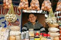Woman in market stall, Lima, Peru