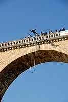 Stock photo a bungee jumper jumping off a viaduct in I'sle Jourdain, France