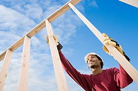 Man holding wooden construction frame
