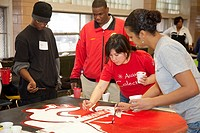 Detroit, Michigan - Volunteers paint murals to hang at Cody High School  They were working as part of a Martin Luther King Day of Service project orga...
