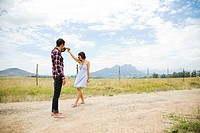Young couple dancing in remote setting