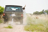 Newlywed woman waving from vehicle (thumbnail)
