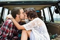 Couple kissing in back of suv