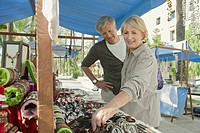 Man and woman shopping at outdoor market