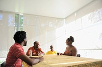 Black family sitting at dining room table