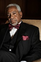 Elegant African American man sitting in chair