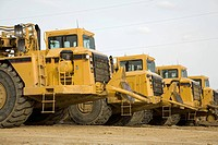 Row of construction loaders