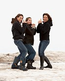 Mother and daughters in Charlie´s Angels pose