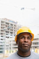 Black construction worker frowning