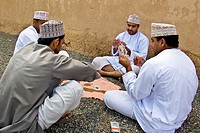 Men playing cards, Jabrin, Sultanate of Oman