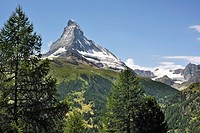 View over the Matterhorn mountain with alpine meadows and pine forests in the Swiss Alps, Valais, Switzerland
