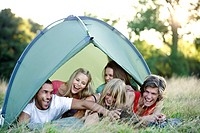 A group of young people in a tent, laughing