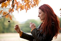 A young woman playing conkers